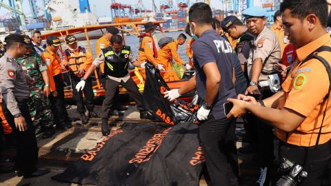 Members of a rescue team line up body bags in Tanjung Priok, North Jakarta, on Monday.