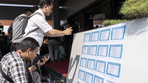People look at the passenger manifest for Lion Air Flight JT 610.