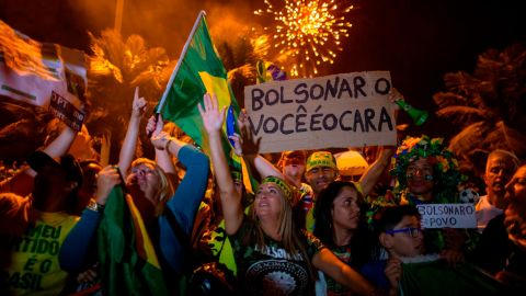 Supporters of far-right presidential candidate Jair Bolsonaro celebrate in front of his house in Rio de Janeiro on October 28.