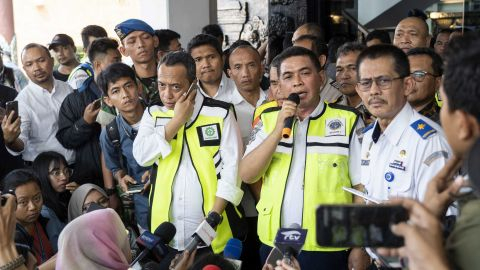 Bagus Sunjoyo, head of airport authority for Soekarno-Hatta International Airport, speaks to members of the media during a news conference.
