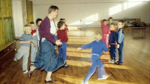 """Merkel visits a children's home during her campaign to become a member of the Bundestag, Germany's parliament, in 1990. Before turning to politics, Merkel had trained as a physician. She was also a spokeswoman for the """"Democratic Awakening,"""" East Germany's opposition movement before reunification."""