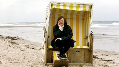 """Merkel sits in a """"strandkorb,"""" or beach basket, in an undated photo. In 2000, Merkel became the Christian Democratic Union's first female chairperson. It was the opposition party at the time."""