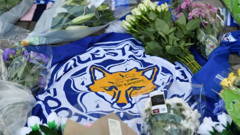 A flag showing the Leicester City Football Club's Fox logo with a message of thanks is seen in a growing pile of tributes outside Leicester City Football Club's King Power Stadium in Leicester, eastern England, on October 28, 2018 after a helicopter belonging to the club's Thai chairman Vichai Srivaddhanaprabha crashed outside the stadium the night before. - Leicester City's charismatic Thai chairman was the subject of growing concerns on October 28 after a helicopter belonging to the billionaire crashed and burst into flames in the stadium carpark shortly after taking off from the club's pitch following the match against West Ham United on October 27. There was no confirmation whether London-based Vichai Srivaddhanaprabha, who frequently flies to and from Leicester's home games by helicopter, was on board the aircraft which appeared to develop mechanical problems. (Photo by Ben STANSALL / AFP)        (Photo credit should read BEN STANSALL/AFP/Getty Images)