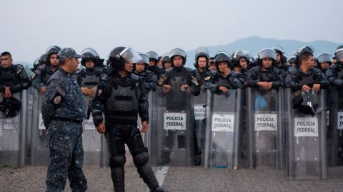 Police said they blocked the caravan to explain Mexico's offer of aid.