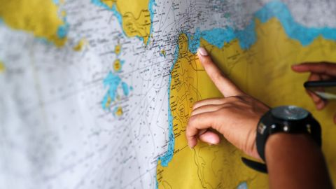 A police officer studies a map in the search-and-rescue command center.
