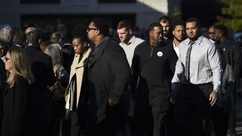 Members of the Pittsburgh Steelers NFL team arrive at the Rodef Shalom Congregation for the funeral.