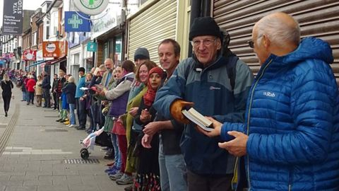 People form human chain to help community bookshop move books