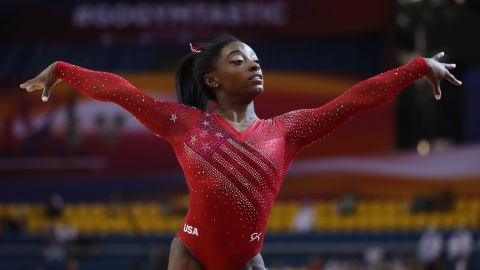 Simone Biles led the US to a record win in the team event and qualified for all five individual finals.