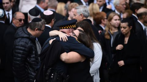 Mourners embrace outside the Rodef Shalom Congregation where the funeral for Tree of Life Congregation mass shooting victims Cecil Rosenthal and David Rosenthal who are brothers will be held October 30, 2018 in Pittsburgh, Pennsylvania. - Much loved brothers Cecil and David Rosenthal, inseparable in life as in death, were treasured members of the Pittsburgh Jewish community, remembered as the sweetest souls and devoted to the synagogue where they were killed. The city on Tuesday bid farewell to the pair, who had developmental disabilites and reportedly lived together, in the first funerals for those killed in the worst anti-Semitic attack in US history. (Photo by Brendan SMIALOWSKI / AFP)        (Photo credit should read BRENDAN SMIALOWSKI/AFP/Getty Images)