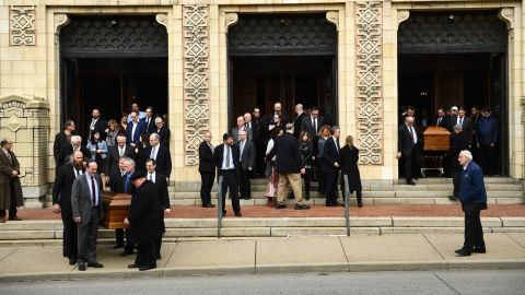 Caskets are carried outside the Rodef Shalom Congregation, scene of the Rosenthal brothers' funeral.