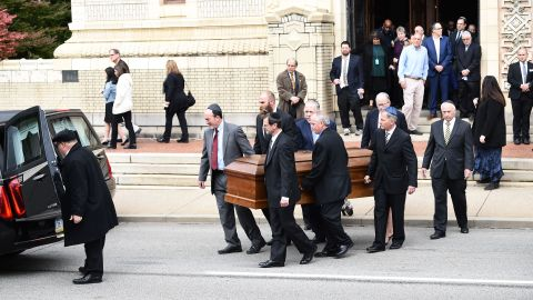 Mourners gather as a casket is carried outside the Rodef Shalom Congregation where the funeral for Tree of Life Congregation mass shooting victims Cecil Rosenthal and David Rosenthal who are brothers will be held October 30, 2018 in Pittsburgh, Pennsylvania. - Much loved brothers Cecil and David Rosenthal, inseparable in life as in death, were treasured members of the Pittsburgh Jewish community, remembered as the sweetest souls and devoted to the synagogue where they were killed. The city on Tuesday bid farewell to the pair, who had developmental disabilites and reportedly lived together, in the first funerals for those killed in the worst anti-Semitic attack in US history. (Photo by Brendan SMIALOWSKI / AFP)        (Photo credit should read BRENDAN SMIALOWSKI/AFP/Getty Images)