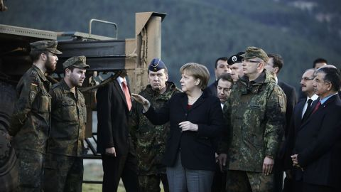 Merkel visits troops stationed in Turkey in February 2013. Later that year she was re-elected for a third term.
