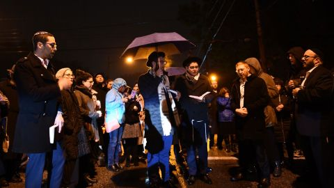 People gather outside the Tree of Life Synagogue after a shooting there left 11 people dead in the Squirrel Hill neighborhood of Pittsburgh on October 27, 2018. - A heavily armed gunman opened fire during a baby-naming ceremony at a synagogue in the US city of Pittsburgh on October 27, killing 11 people and injuring six in the deadliest anti-Semitic attack in recent American history.