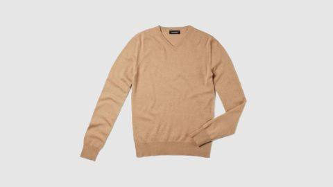 """<a href=""""https://naadam.co/products/the-essential-75-cashmere-sweater-camel"""" target=""""_blank"""" target=""""_blank""""><strong>Naadam The Essential $75 Cashmere V-Neck Sweater ($75; naadam.com) </strong></a>"""