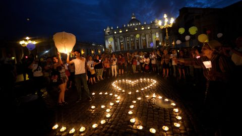 Demonstrators stand by candles shaping a heart and the number 30 as they coomemorate the 30th anniversary of Emanuela Orlandi disappearance in Saint Peter's Square at the Vatican on June 22, 2013