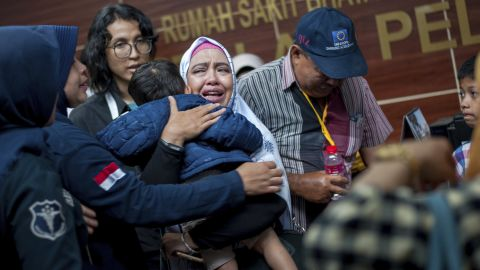 A relative of a passenger cries at a Jakarta hospital on Tuesday, October 30. Family members have been providing authorities with DNA samples to help identify victims of the crash.
