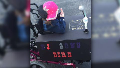 Because female DJs are rare, Julia dressed up as a DJ, and the wheelchair was her booth.