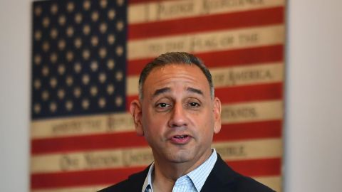 California Democratic candidate for the 39th Congressional District Gil Cisneros speaks at a Veterans luncheon at campaign headquarters in Fullerton, South East of Los Angeles, California on October 11, 2018. - Cisneros, a former Lieutenant Commander, is running against Repuplican candidate Young Kim in a race to represent California's 39th Congressional District.