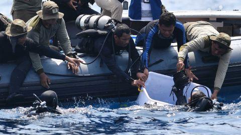 Indonesian Navy divers recover a flight data recorder on Thursday, November 1.