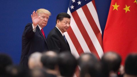 """TOPSHOT - US President Donald Trump (L) and China's President Xi Jinping leave a business leaders event at the Great Hall of the People in Beijing on November 9, 2017.Donald Trump urged Chinese leader Xi Jinping to work """"hard"""" and act fast to help resolve the North Korean nuclear crisis, during their meeting in Beijing on November 9, warning that """"time is quickly running out"""". / AFP PHOTO / Nicolas ASFOURI        (Photo credit should read NICOLAS ASFOURI/AFP/Getty Images)"""