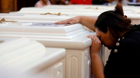 A relative of a slain Christian grieves during a funeral service Saturday in Minya, Egypt.