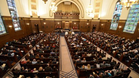 Congregants of various faiths gather Friday with the Rodef Shalom congregation in Pittsburgh.