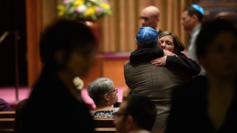 People of faith greet each other in the sanctuary at Temple Sinai before Friday evening Shabbat services. Temple Sinai opened its doors to Pittsburgh-area Jews and people of all faiths.