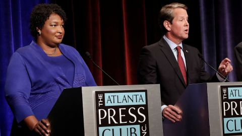 FILE PHOTO: Republican gubernatorial candidate for Georgia Brian Kemp speaks as Democratic candidate Stacey Abrams looks on during a debate in Atlanta, Georgia, U.S, October 23, 2018. Picture taken on October 23, 2018. John Bazemore/Pool via REUTERS/File Photo