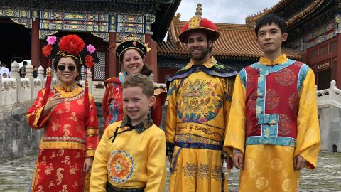 """A photo of Gavin in Beijing's Forbidden City was captioned, """"I'm dressed in an imperial robe, but I'm not really happy."""""""
