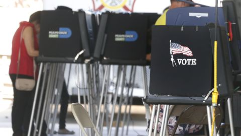 South Florida voters cast their ballots at a polling center in Miami, Florida on November 6, 2018. - Americans started voting Tuesday in critical midterm elections that mark the first major voter test of US President Donald Trump's controversial presidency, with control of Congress at stake. (Photo by RHONA WISE / AFP)        (Photo credit should read RHONA WISE/AFP/Getty Images)