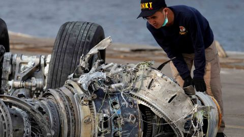An Indonesian National Transportation Safety Commission official examines a turbine engine from the Lion Air flight 610 in Jakarta, Indonesia, on November 4, 2018.