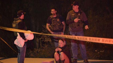 Sheriff's deputies speak to a possible witness.