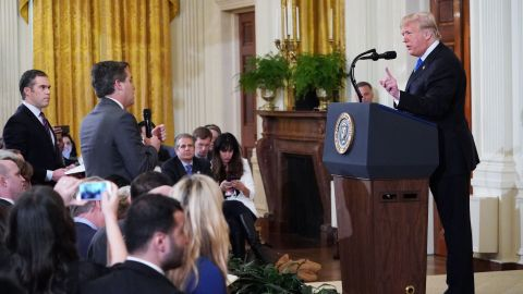 US President Donald Trump (R) gets into a heated exchange with CNN chief White House correspondent Jim Acosta (C) as NBC correspondent Peter Alexander (L) looks on during a post-election press conference in the East Room of the White House in Washington, DC on November 7, 2018. (Photo by MANDEL NGAN / AFP)        (Photo credit should read MANDEL NGAN/AFP/Getty Images)