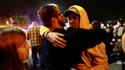 Holden Harrah, 21, right, hugs family and friends after witnessing the shooting.