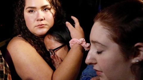 Nellie Wong cries as Chyann Worrell holds her and Erika Sigman, right, stands beside them. All three were inside the Borderline Bar and Grill when shooting started.