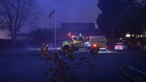 A fire emergency crew works to protect the Paradise Town Hall from the encroaching Camp Fire on November 8.