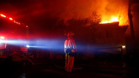 Firefighters battle flames in Thousand Oaks early on November 9.