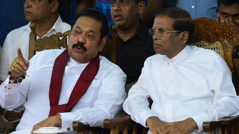 Sri Lanka's President Maithripala Sirisena (R) and disputed prime minister Mahinda Rajapaksa speak during a rally in Colombo on November 5.