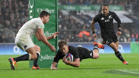 All Black Damian McKenzie scores his team's first try.
