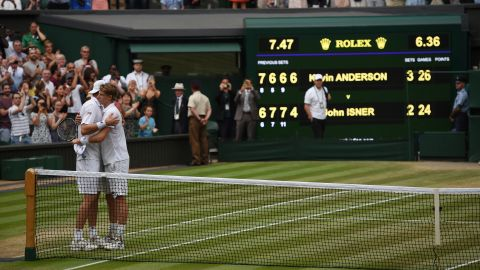 Kevin Anderson (right) and John Isner hug at the net after their six-and-a-half hour Wimbledon semifinal in July.