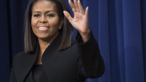 """US First Lady Michelle Obama speaks following a screening of the movie, """"Hidden Figures,"""" in the Eisenhower Executive Office Building adjacent to the White House in Washington, DC, December 15, 2016. / AFP / SAUL LOEB        (Photo credit should read SAUL LOEB/AFP/Getty Images)"""