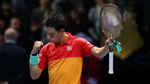 Japan's Kei Nishikori celebrates match point against Roger Federer of Switzerland during Day One of the Nitto ATP World Tour Finals.