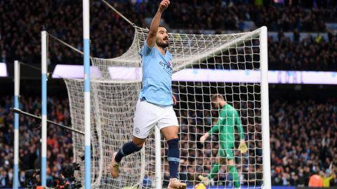 Ilkay Gundogan of Manchester City celebrates after scoring his team's third goal against cross-town rival Manchester United.