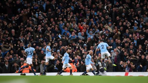 David Silva celebrates with teammates after scoring the first goal during the Manchester derby at the Etihad Stadium.
