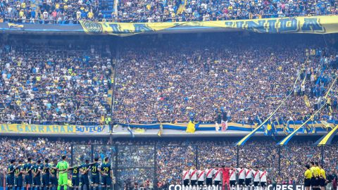 Boca Juniors and River Plate line up ahead of the first leg of the Copa Liberdatores final first leg at the Bombonera stadium in Buenos Aires.