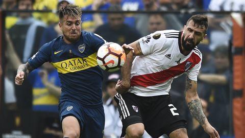 Julio Buffarini of Boca Juniors fights for the ball with River Plate's Lucas Pratto.