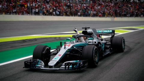 Mercedes' British driver Lewis Hamilton waves from his car after winning the F1 Brazil Grand Prix at the Interlagos racetrack in Sao Paulo, Brazil.
