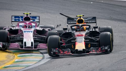 Force India driver Estaban Ocon crashes into Red Bull's Max Verstappen during the race.