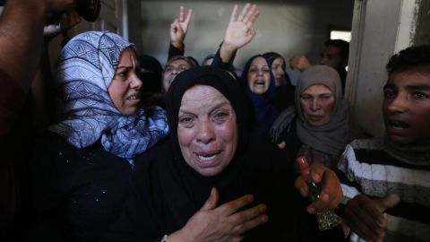Relatives mourn a Palestinian man killed in an Israeli airstrike in Khan Younis, Gaza, on Monday.