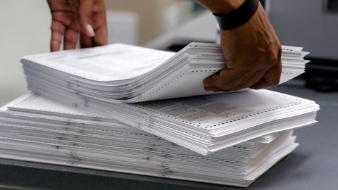 LAUDERHILL, FL - NOVEMBER 11: Elections staff load ballots into machine as recounting is underway at the Broward County Supervisor of Elections Office on November 11, 2018 in Lauderhill, Florida. A statewide vote recount is being conducted to determine the races for governor, Senate, and agriculture commissioner. (Photo by Joe Skipper/Getty Images)